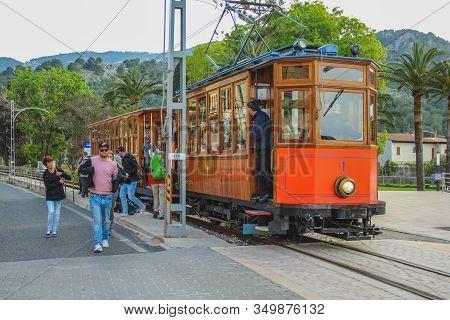 Port De Soller, Mallorca, Spain - March 19 2018: Famous Tramway With Tourists Arrives At Port De Sol