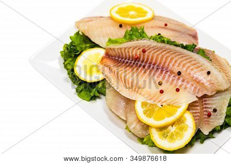 Whitefish Tilapia Fish Raw Fillet Isolated On White Background. Selective Focus.