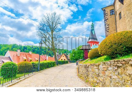 Cobblestone Path Road To Medieval Loket Castle (hrad Loket) Gothic Style Building With Stone Walls,
