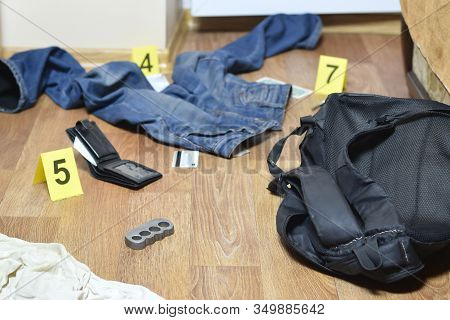 Crime Scene Investigation - Numbering Of Evidences After The Murdering In Apartment. Brass Knuckle,