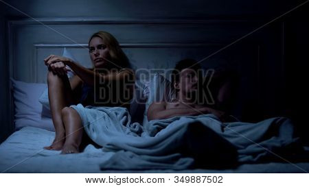 Indifference, Couple Ignoring Each Other, Sitting On Bed, Relationship Problems