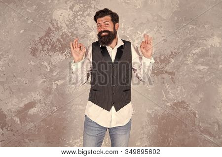 Living Happy Life. Happy Hipster Gesture Ok On Abstract Wall. Emotional Guy With Long Mustache And B