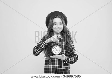 Retro Is Timeless. Happy Small Child Holding Retro Clock On Yellow Background. Little Girl Smiling W