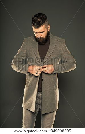 Dressing As Fashionable Man. Fashionable Look Of Vogue Model On Grey Background. Bearded Man Buttoni