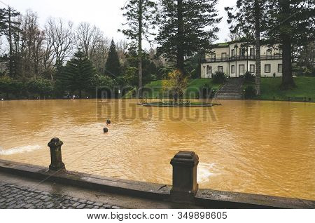 Furnas, Azores, Portugal - Jan 13, 2020: Hot Spring Iron Water Thermal Pool In Terra Nostra Garden.