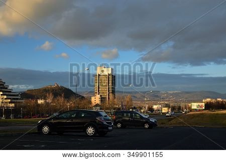 Most, Czech Republic - January 29, 2020: Centre Of City With High Houses, Hill And Hnevin Castle In