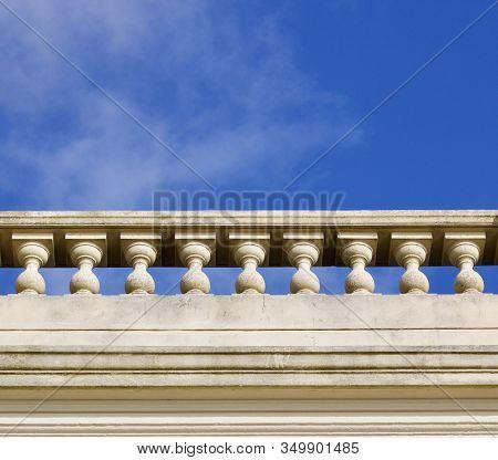 White Ornamental Stone Balustrade Against Blue Sky