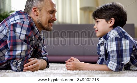 Caring Dad Praising His Little Son, Fathers Care And Support, Time Together