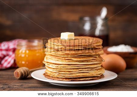 Blini Or Crepe Or Thin Pancakes Stack On Wooden Table Topped With Butter. Shrove Tuesday, Maslenitsa