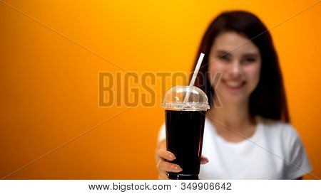 Happy Girl Showing Diet Soda To Camera, Low Calorie Drink, Healthy Lifestyle