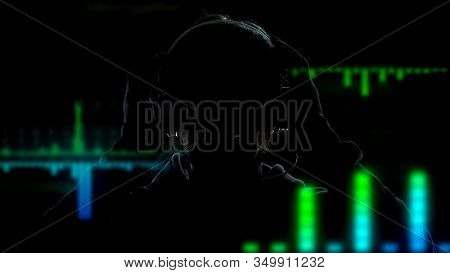 Deejay In Headphones Playing And Mixing Music On Equalizer Effects Background