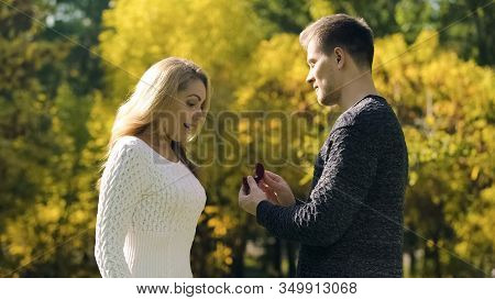 Surprise Proposal In Fall Park, Excited Couple, Engagement With Ring, Happiness