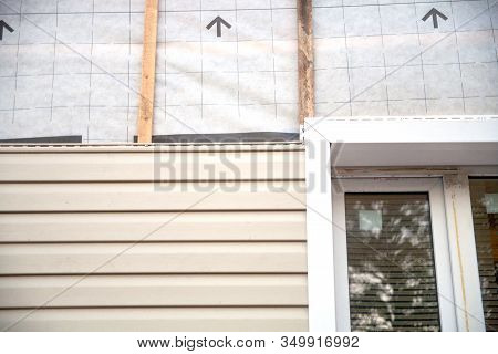 Wall Covering Of The Frame House With Panels Of Vinyl Siding Of Gray Color. Decorating The House Wit