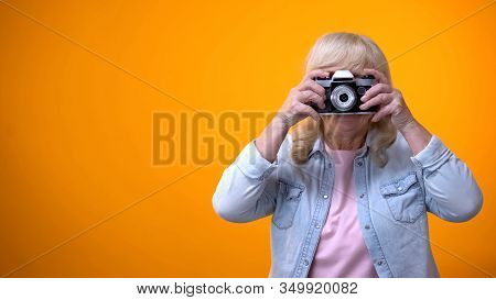 Happy Smiling Retiree Woman Taking Photo, Hobby And Relaxation, Leisure Time