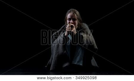 Hopeless Depressed Homeless Woman Eating Bread Sitting In Darkness, Abuse Victim