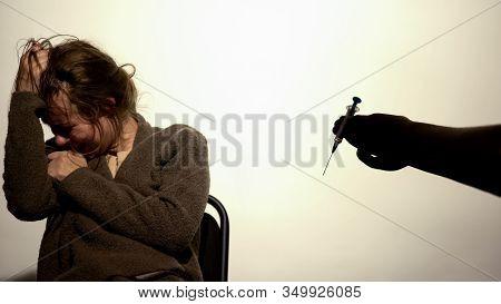 Hand Giving Syringe To Weak-willed Female, Addiction Hopelessness, Drugs Rehab