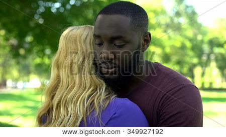 Sad Afro-american Man Hugging Woman Divorce Caused By Intimidation And Hostility