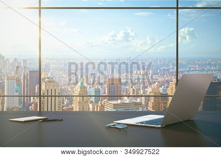 Contemporary Business Desktop With Laptop And Megapolis City View. Mock Up, 3d Rendering