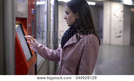 Female Withdrawing Money From Automated Teller Machine, Banking Operations