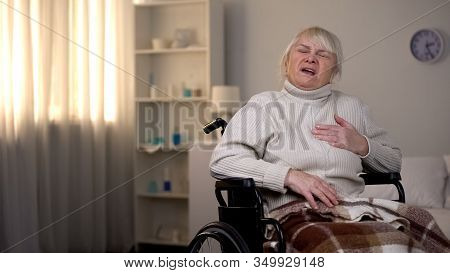 Pensioner In Wheelchair Feeling Chest Pain, Heart Attack, Myocardial Infarction