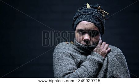 Female Refugee Freezing Outdoors, Trying To Warm Up, Searching For Shelter