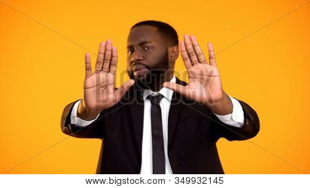 Black Male Showing Stop Sign Expressing Protest Against Bribery And Law Offence