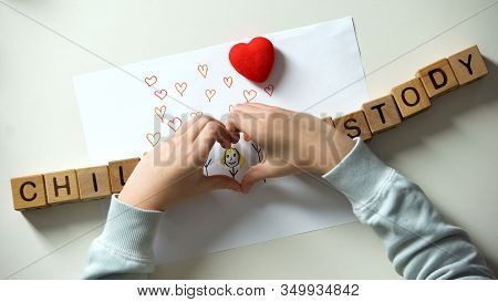 Child Custody Phrase And Heart Sign Made From Hands On Family Painting, Orphan