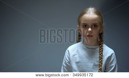 Sad Female Child Looking At Camera, Bullying And Family Violence Witness