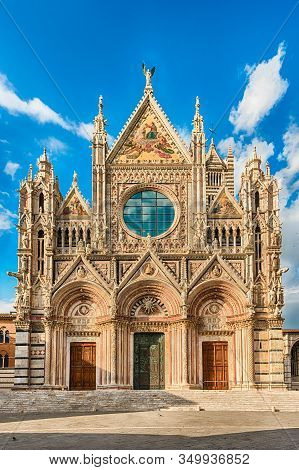 View Of The Facade Of The Gothic Cathedral Of Siena, Tuscany, Italy. Completed In 1348, The Church I