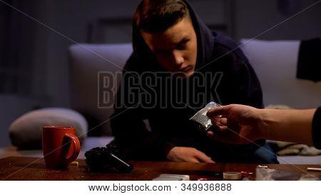 Drug Dealer Offering Addicted Teenager Weed Dose, Criminal Activity, Abuse