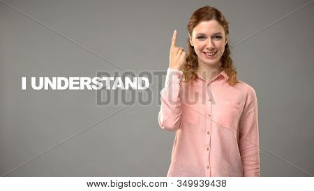 Teacher Saying I Understand In Asl, Text On Background, Communication For Deaf