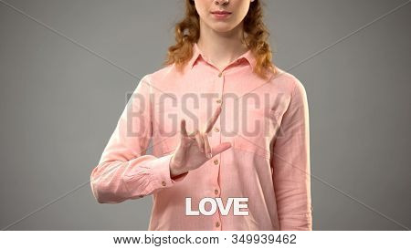 Female Showing Love In Asl, Text On Background, Nonverbal Communication For Deaf