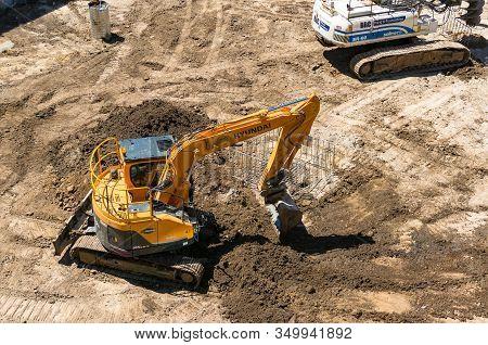 Melbourne, Australia - December 7, 2016: Yellow Earth Mover, Excavator On Contruction Site. Heavy Bu