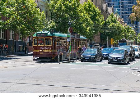 Melbourne, Australia - December 7, 2016: Melbourne Cbd Road With Historic Tramway And Modern Cars On