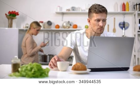 Couple Using Gadgets In Kitchen, Ignoring Live Communication, Addiction Concept