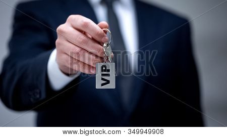 Vip Word On Keychain In Male Hand, Luxury Accommodation For Business Trip