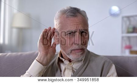 Confused Pensioner Trying To Hear Conversation, Problem Of Deafness In Old Age