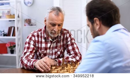 Serious Senior Male Playing Chess With Opponent, Complicated Competition, Sport