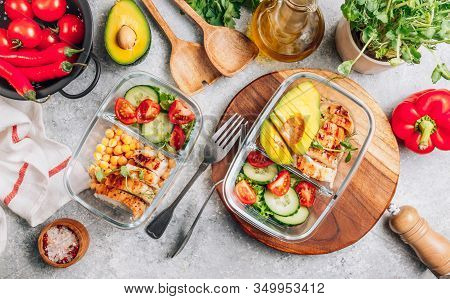 Healthy Meal Prep Containers With Chickpeas, Chicken, Tomatoes, Cucumbers And Avocados. Healthy Lunc