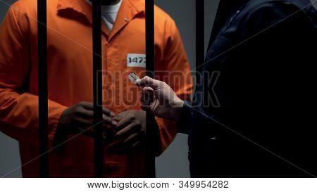 Corrupt Officer Giving Black Imprisoned Criminal Blade, Revolt Preparation