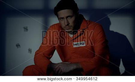Caucasian Prisoner Looking At Camera In Individual Cell, Life Sentence, Guilty