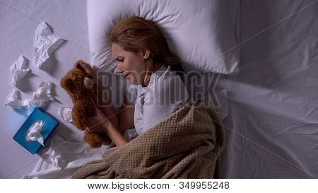 Depressed Woman In Bed Crying, Hugging Toy Bear, Suffering From Miscarriage