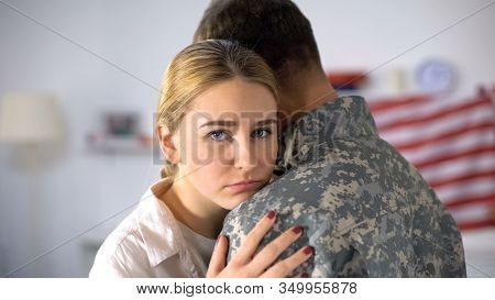 Sad Woman Embracing Soldier Leaving Home, Farewell Before Military Service