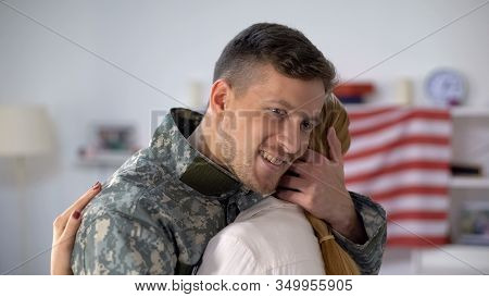 Happy Us Soldier Embracing Wife With Love, Homecoming After Military Service