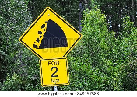 A Warning Falling Rocks For Two Km Sign