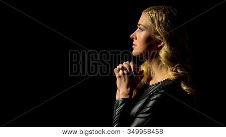 Sinner Confession, Young Woman Praying In Darkness Under Heaven Light, Hope