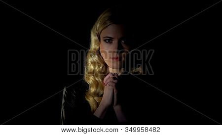 Female Sinner Praying In Dark Room, Looking For Forgiveness, Faith And Belief