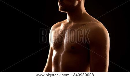 Masculine Sweaty Man Standing Against Black Background, Athletic Healthy Body