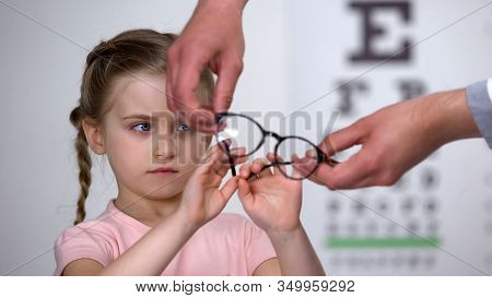 Upset Little Girl Rejecting Glasses, Child Feels Insecure In Eyewear, Discomfort