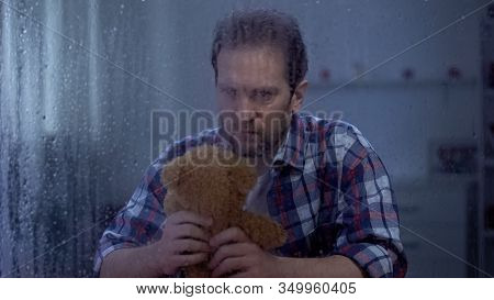 Desperate Male Holding Teddy Bear, Suffering Pain Of Child Loss Terrible Tragedy